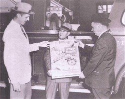 3 Men Holding a Fire Safety Poster
