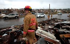 Firefighter Standing in Debris