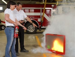 Two People Using a Fire Extinguisher